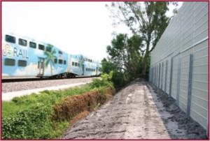 rail noise absorbing barrier wall construction