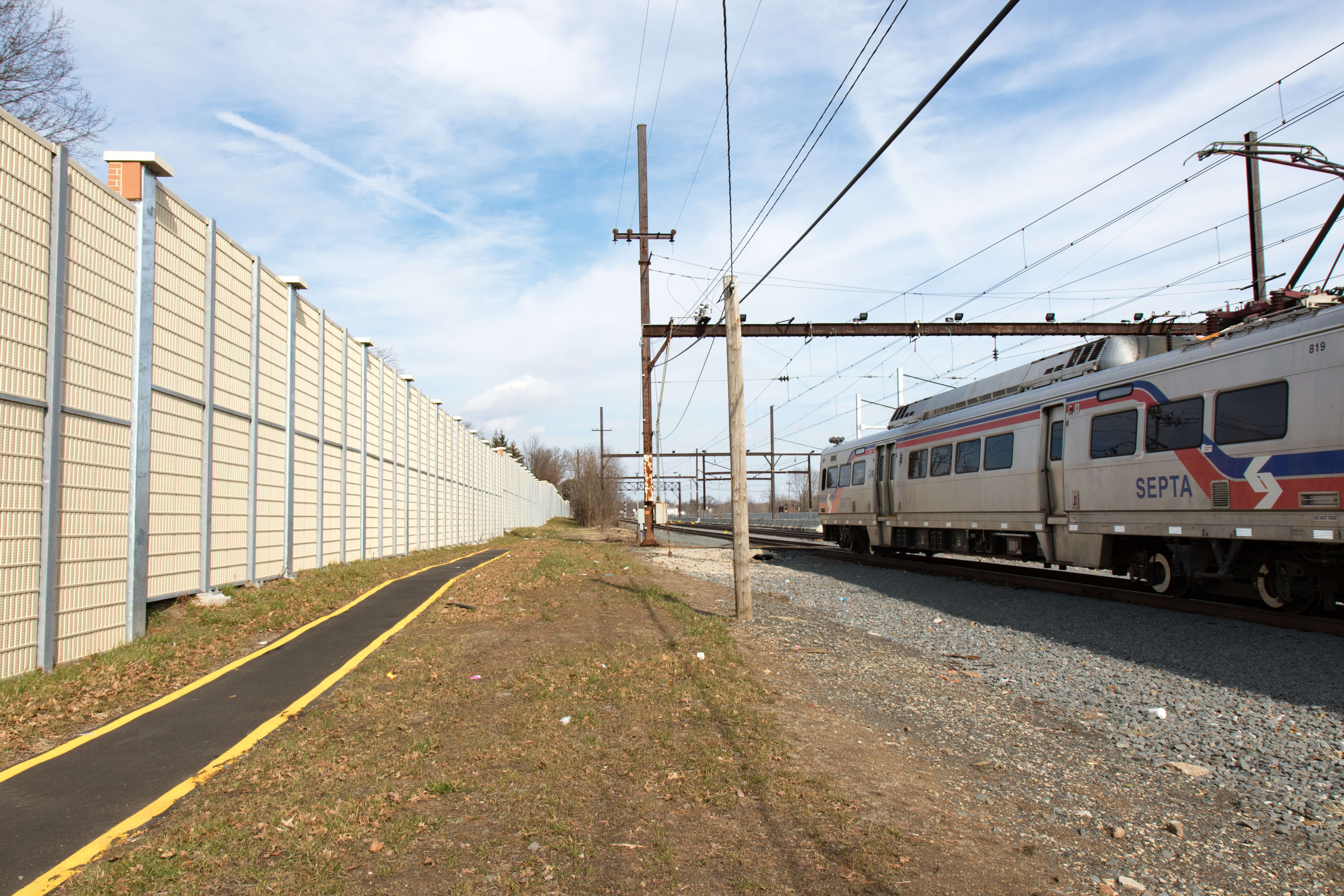 Railroad Noise Barrier Providing Residents and Businesses